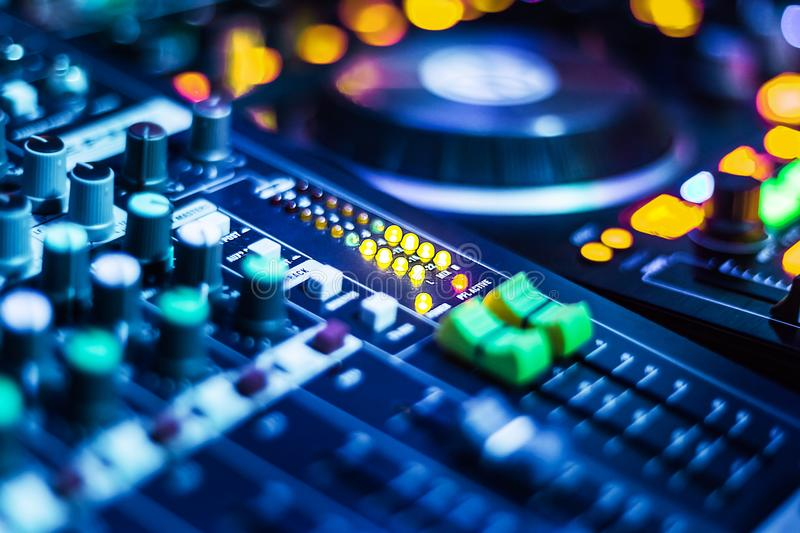 Audio Mixer dj set. Audio Control set with adjusted slide bar for DJ in night club. DJ professional sound mixer technology. Buttons, cables and tabs of the audio stock images