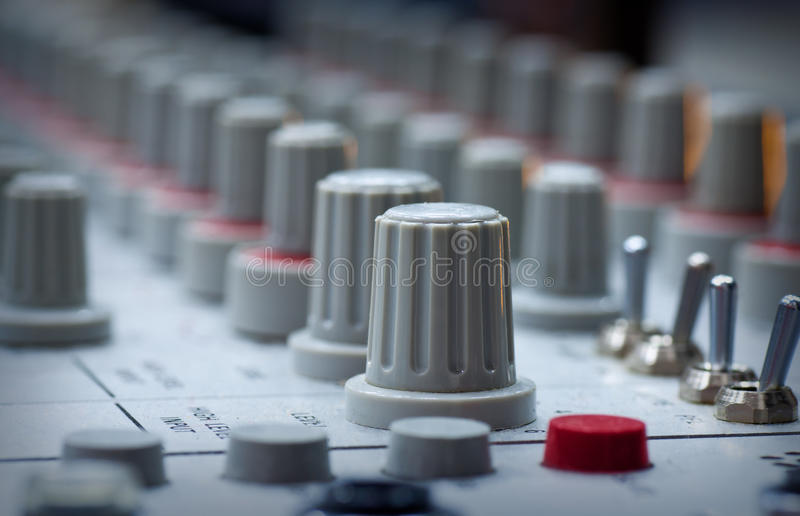 Audio mixing board. Pro audio mixing board at a recording studio royalty free stock images