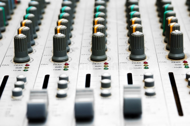 Audio mixing board. With shallow DOF stock photography