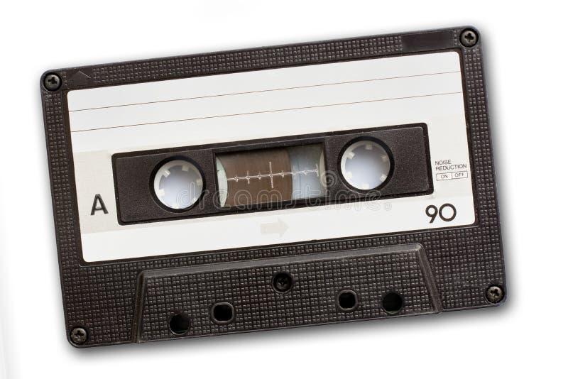 Audio nastro a cassetta isolato su fondo bianco, musica del ` s dell'annata 80 fotografie stock libere da diritti
