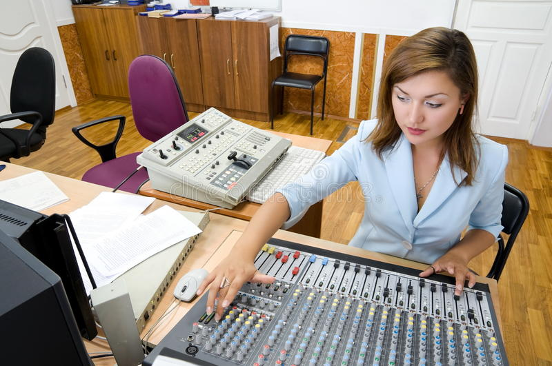 audio operator at audio control console stock photography