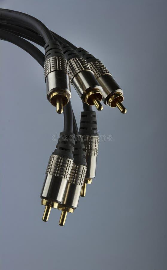 Audio plugs on grey background stock image