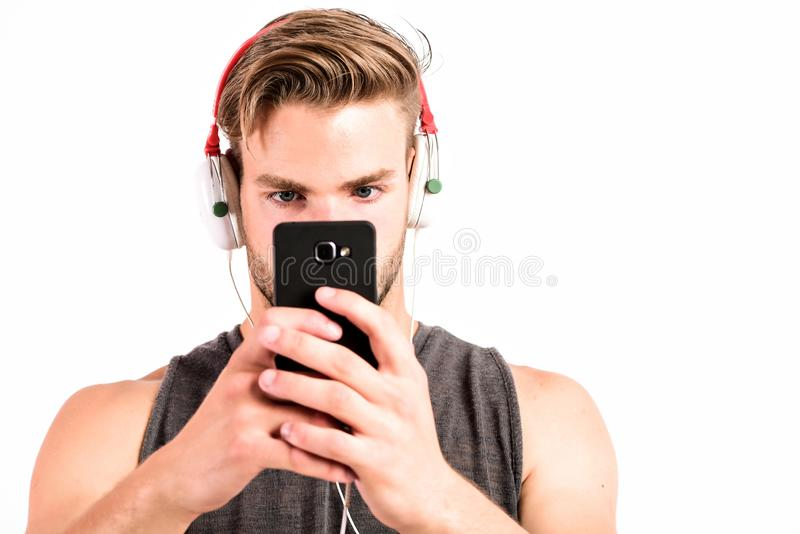 Audio quality. Modern earphones. Music application smartphone. Inspiring music concept. Man handsome unshaven hipster royalty free stock images