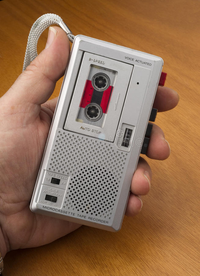 Audio Recorder using Tape the Old Fashioned Way. Male Hand Holds Audio Recorder using Tape for documenting sound royalty free stock photography