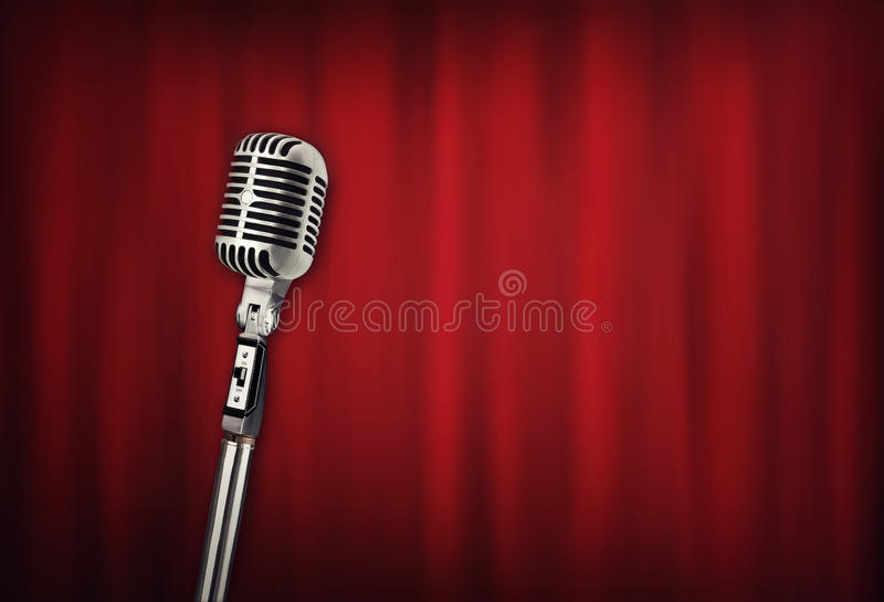 Audio retro microphone with red curtain stock image
