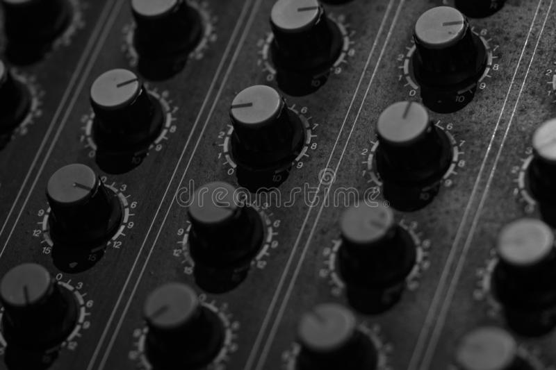 Audio sound mixer console. Sound mixing desk. Music mixer control panel in recording studio. Audio mixing console and adjusting. Knob. Sound engineer. Sound stock images