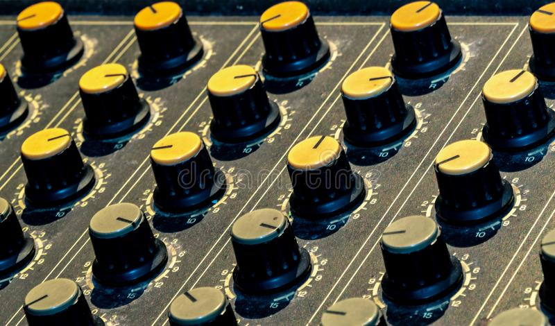Audio sound mixer console. Sound mixing desk. Music mixer control panel in recording studio. Audio mixing console with faders and. Adjusting knob. Sound royalty free stock image