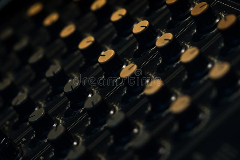Audio sound mixer console. Sound mixing desk. Music mixer control panel in recording studio. Audio mixing console with faders. And adjusting knob. Sound stock photo