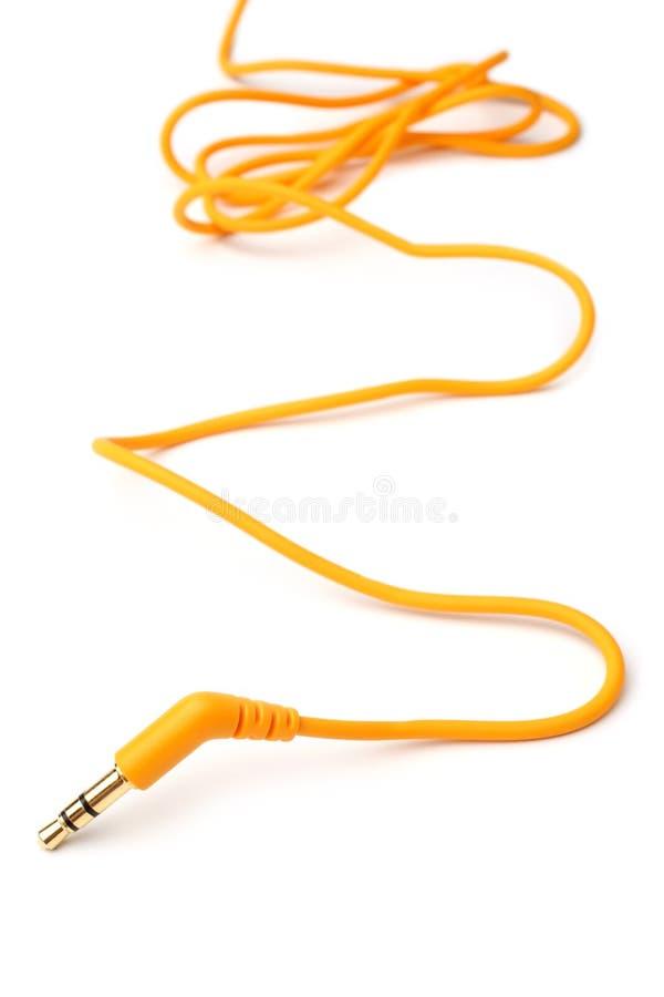 Audio spina di presa arancio del cavo 3,5mm fotografia stock