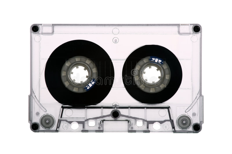 Audio tape cassette. A backlit view from an old audio tape cassette isolated on white background stock images