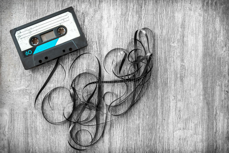 audio tape rolled out background wood vintage unroll compact cassette playlist musicassette royalty free stock photography