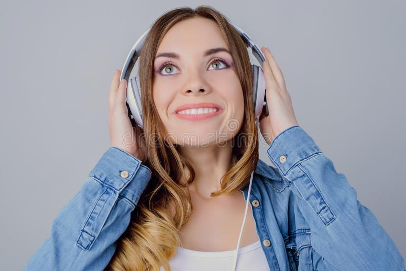 Audio toothy tune trend style stylish casual concept. Close up portrait of charming beautiful excited joyful dreamy lovely girl to. Uching white headphones with stock photo