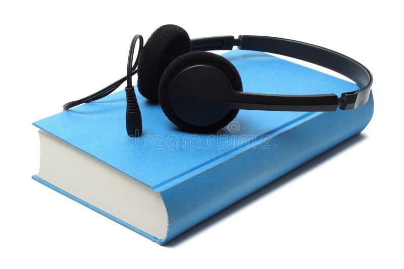 Audiolibro e cuffie fotografie stock libere da diritti