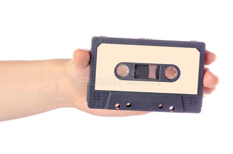 Audiostereomusik der kassette in der Hand stockbild