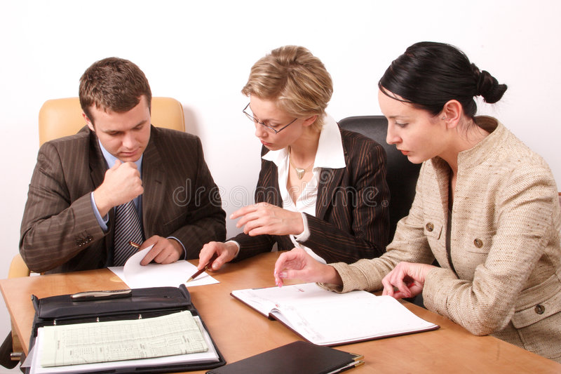Audit. Group of business people working at the desk in the office royalty free stock photos
