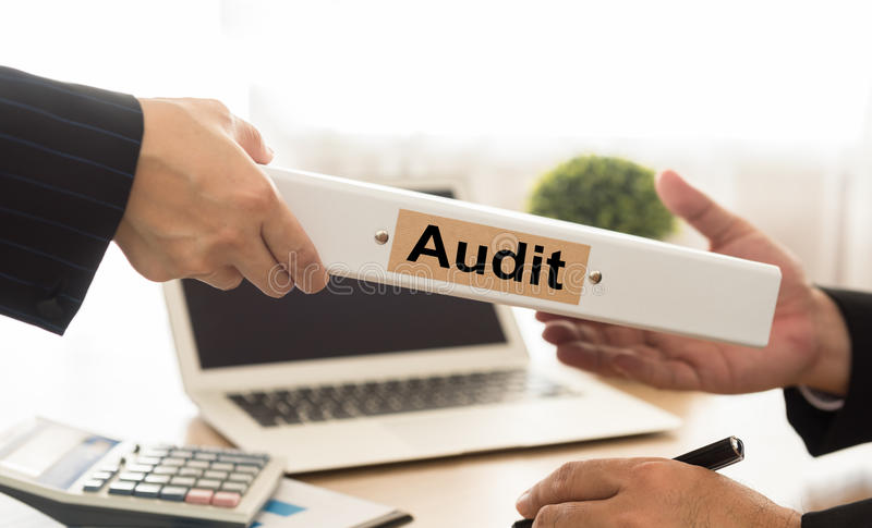 Audit. Or sends file ed financial statements of the Company to executives stock photo