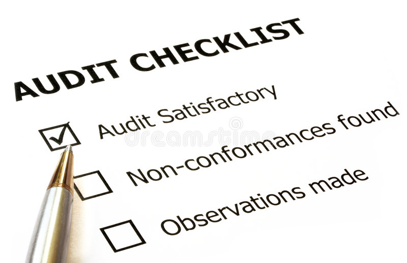 Audit Checklist. With silver and gold ballpoint. Check in audit satisfactory box royalty free stock photography