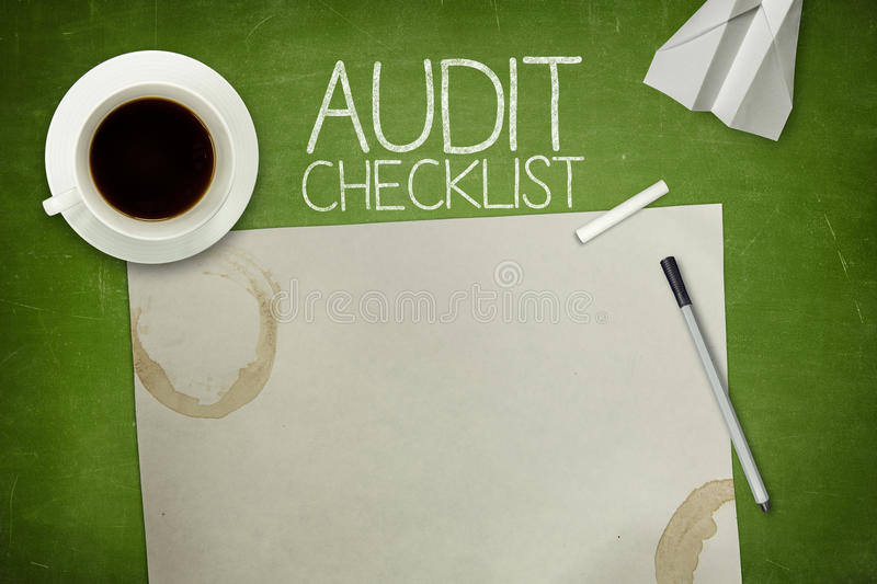 Audit checklist concept on blackboard with empty stock photos