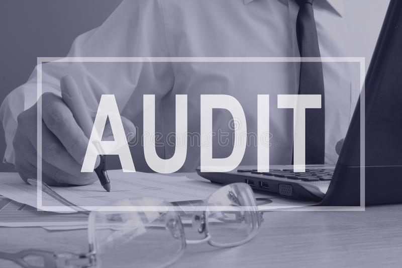 Audit concept. Auditor working with ledger. stock image
