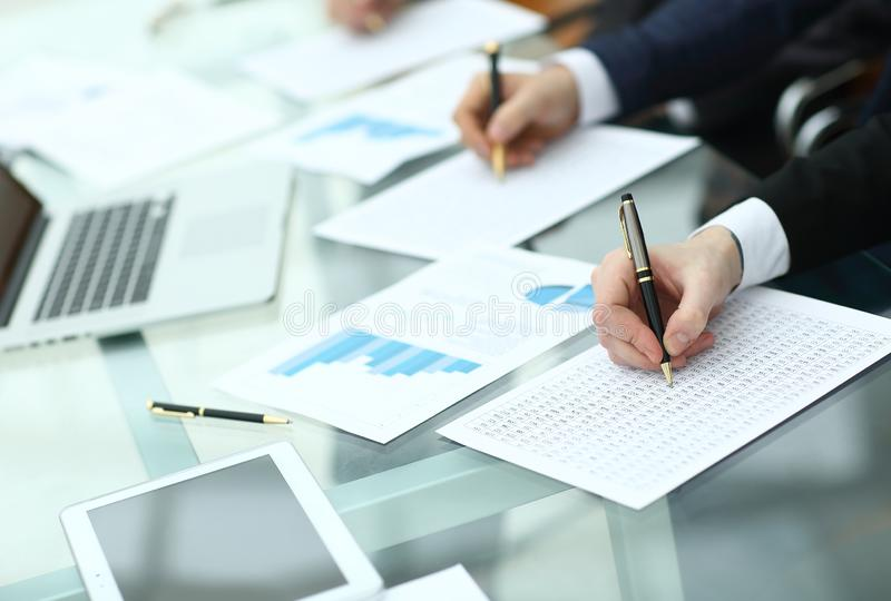 Audit concept at working with plan and analyzing investment charts at workplace.  stock photo