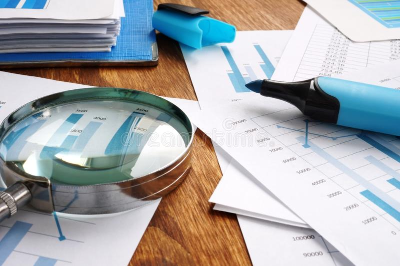 Audit and financial accounting. Magnifier and business report stock photo