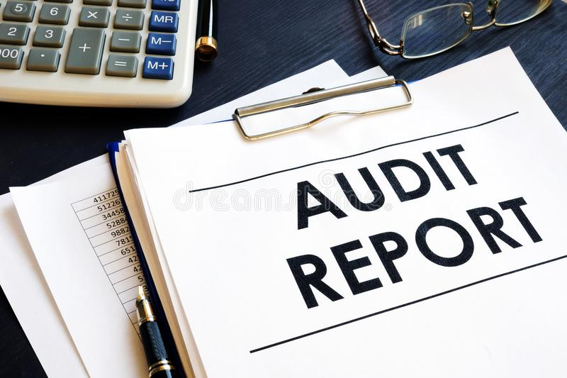 Audit report with business documents in an office. Audit report with business documents in the office royalty free stock images