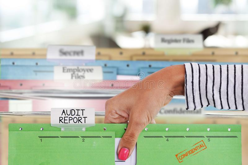 Audit report files or document in businesswoman's hand royalty free stock photography