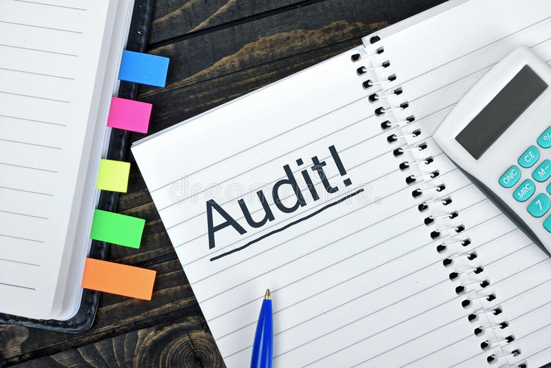 Audit text on notepad stock photography