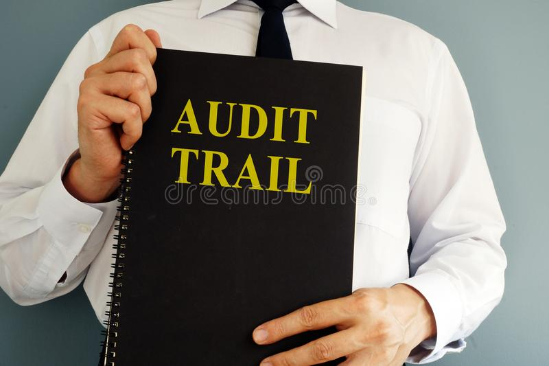 Audit trail concept. Auditor holding book. stock image