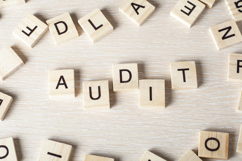 AUDIT word written on wood block. Wooden Abc royalty free stock image