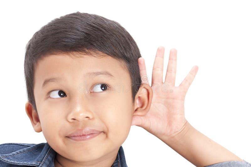 Audition d'enfant de portrait de plan rapproché quelque chose photographie stock