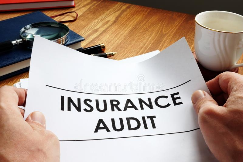 Auditor holding Insurance audit report stock photos