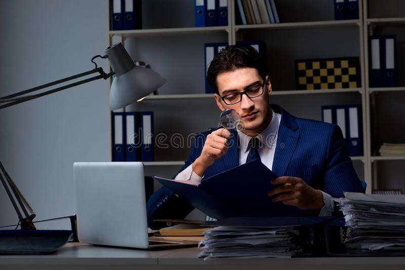 The auditor looking for errors in financial reporting for company. Auditor looking for errors in financial reporting for company royalty free stock photography