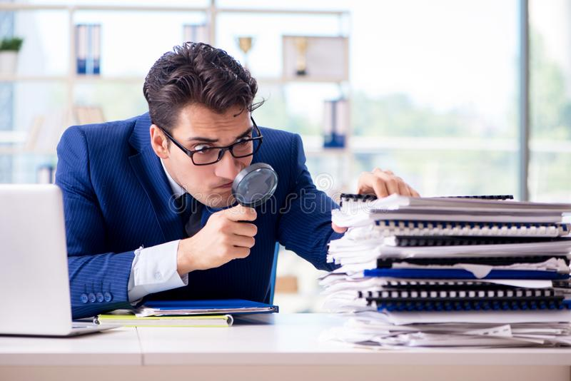 The auditor looking for errors in the financial statements royalty free stock images
