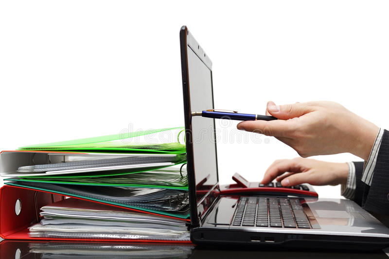 Auditor pointing with pen on laptop screen, showing info royalty free stock image