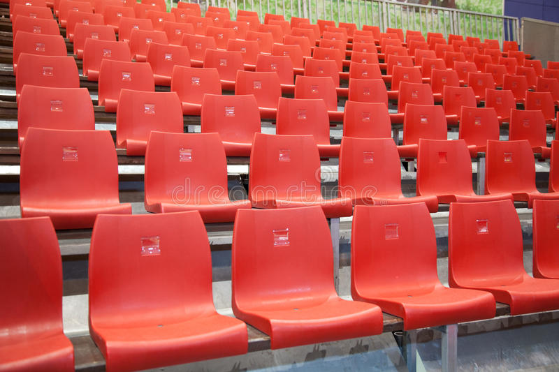 Auditorium with red chairs. Auditorium of red plastic chairs waiting for audience royalty free stock photos