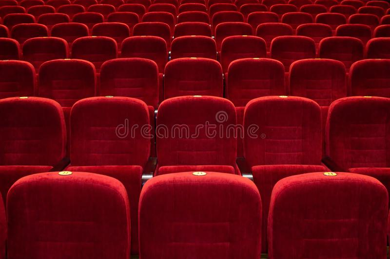 The auditorium, red seats, the seats in the cinema stock photos