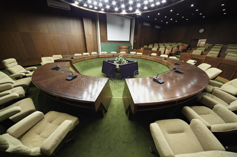 Auditorium with round table and armchairs