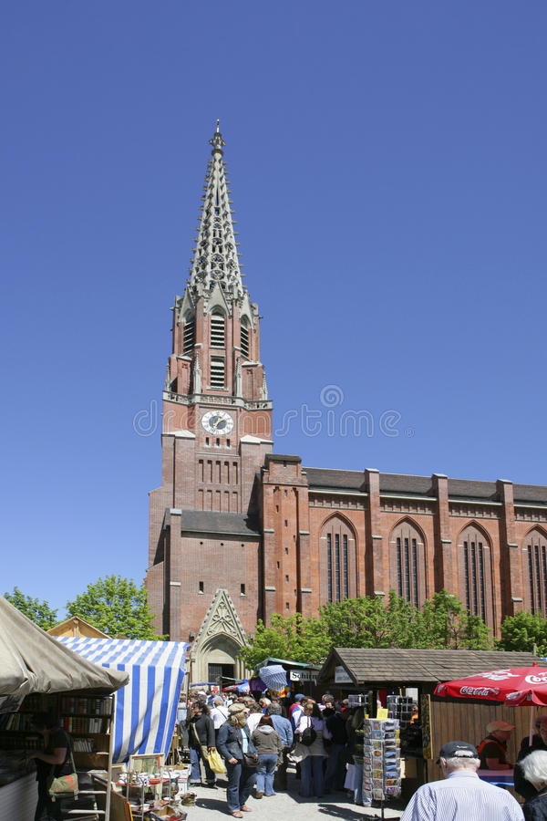 Auer Dult market in front of Mariahilf Church in Munich. Auer Dult market in front of Mariahilf Church, Mariahilfplatz Square, Munich, Bavaria, Germany, Europe stock photography