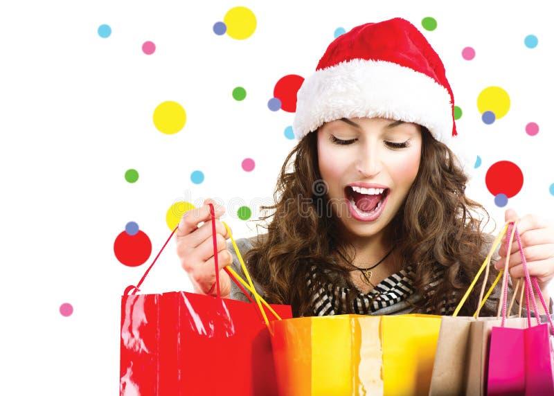 Auf den Zeichen, zum der Weihnachtsglocken zu hängen Überraschte Frau lizenzfreie stockbilder