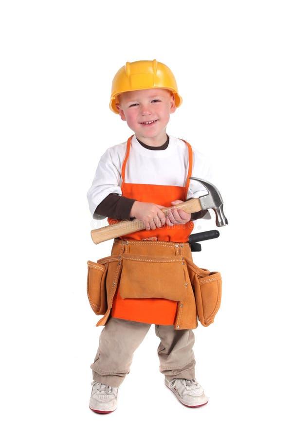 Aufbau-Gebäude-Arbeitskraft, die harten Hut trägt stockfotografie