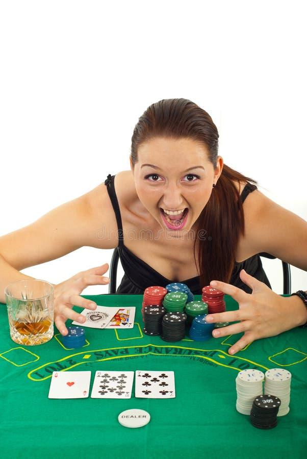 Aufgeregte Frau gewann am Kasino lizenzfreies stockbild