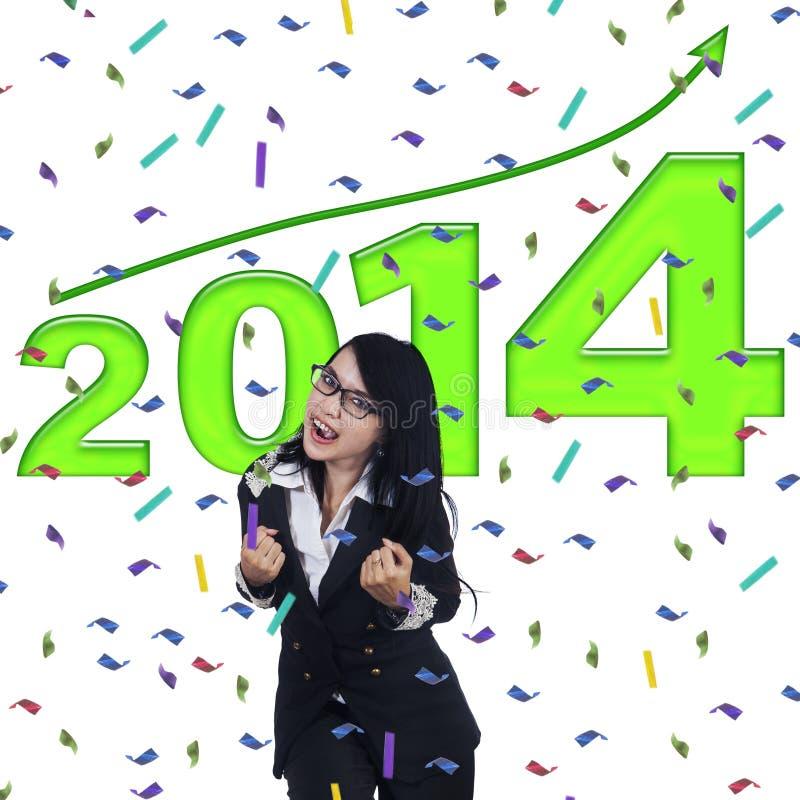 Aufgeregte Geschäftsfrau, die neues Jahr feiert lizenzfreie stockbilder