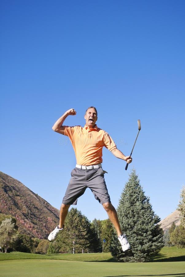 Aufgeregter Golfspieler lizenzfreie stockbilder