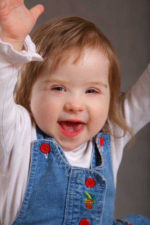 Aufgeregtes behindertes Kleinkind stockfoto