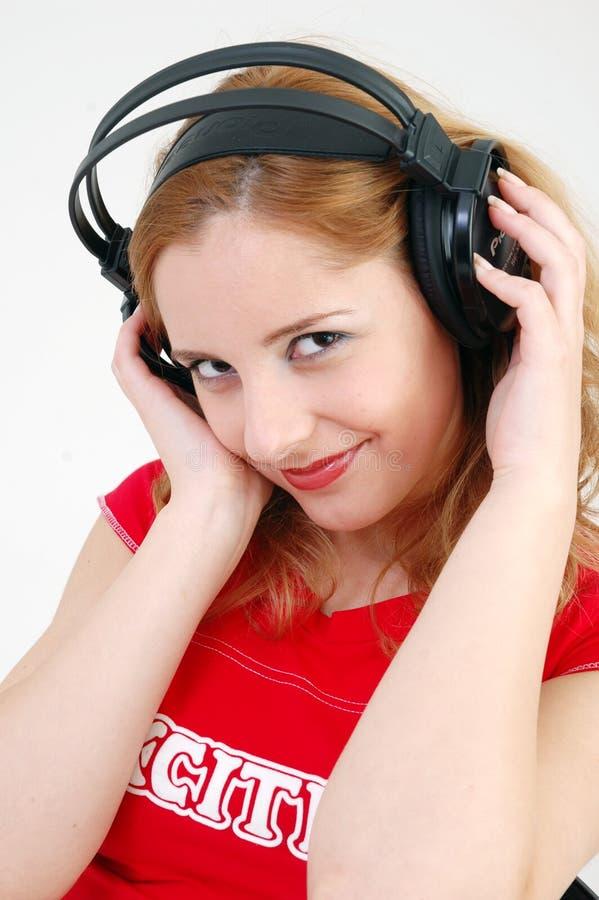 Aufregendes Mädchen mit Kopfhörer stockbild