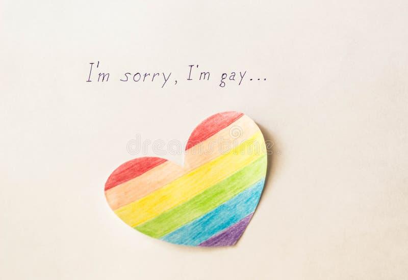 Aufschrift auf weißem Hintergrund I ` m tut mir leid Homosexuellem und Herz in Form einer Flagge von lgbt, Homosexualität lizenzfreie stockfotos