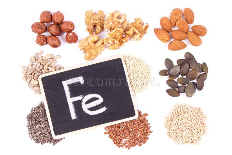 Aufschrift-F.E. mit gesunden Bestandteilen als Quelleisen, Omega-Säuren, Vitaminen, Mineralien und Faser stockbilder