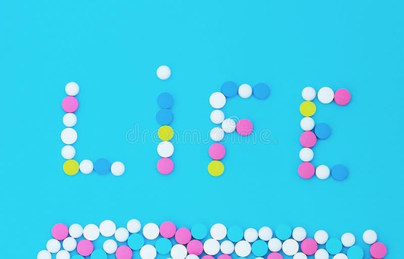 Aufschriftleben von den Tabletten auf einem blauen Hintergrund stockfoto