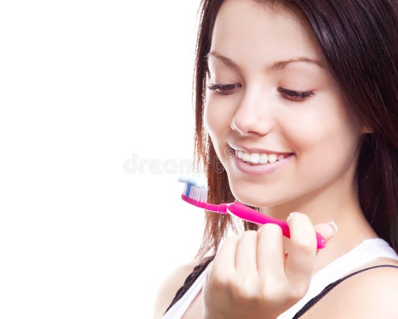 Auftragende Zähne der Frau lizenzfreie stockfotografie